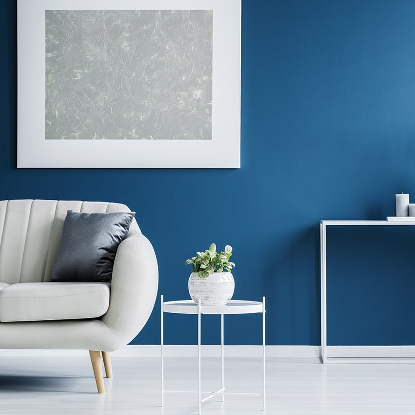 Home interior wall painting with a pantone classic blue wall lends a feeling of peace and calm
