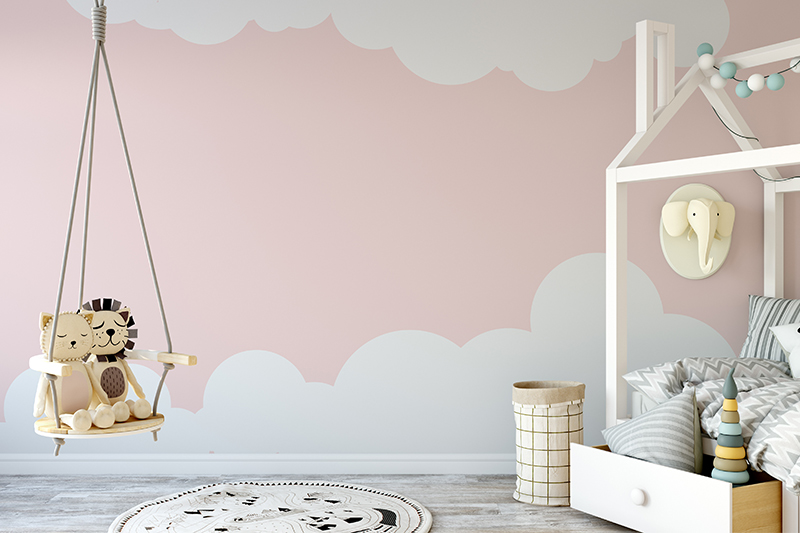 Nursery room decor with clouds printed on the wall with jungle book theme in wall designs for nursery