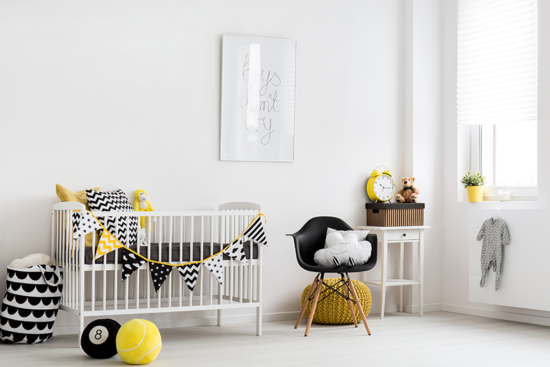 Nursery design for your baby with a white decor and same colour babyhug