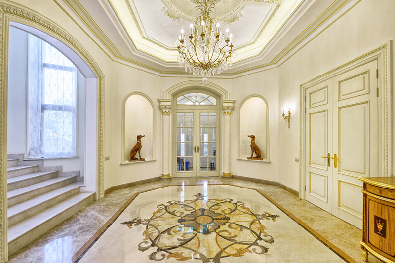 Marble floor design which is outstanding with the colours of the furniture and marble design in hall
