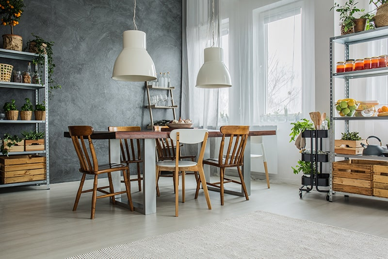 Rustic wooden dining table suitable for apartment setting with modern look