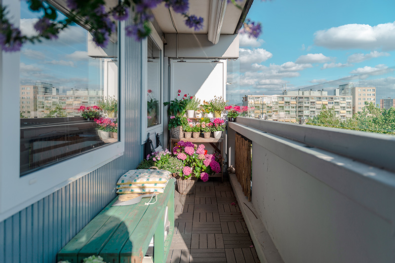 Balcony decoration ideas where a bench serves the dual purpose of taking care of seating arrangements for balcony decoration with lights