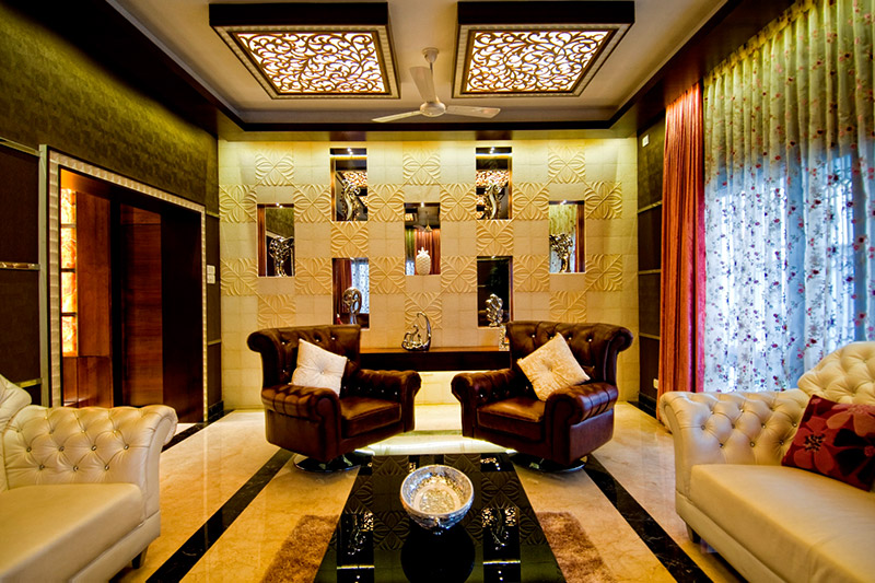 Marble floor design for drawing room accentuated with a border in a darker shade of the stone.