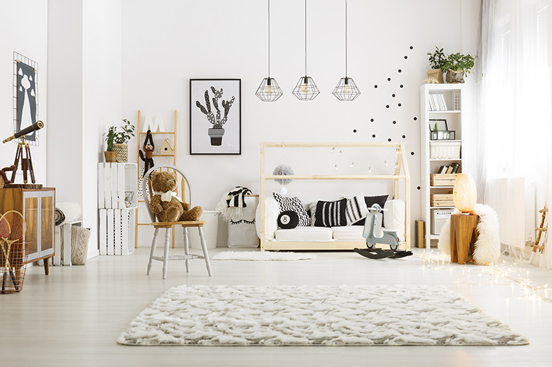 Kids decor for your home with shades of black and soft toys, planters and matching rugs for kids playroom decor