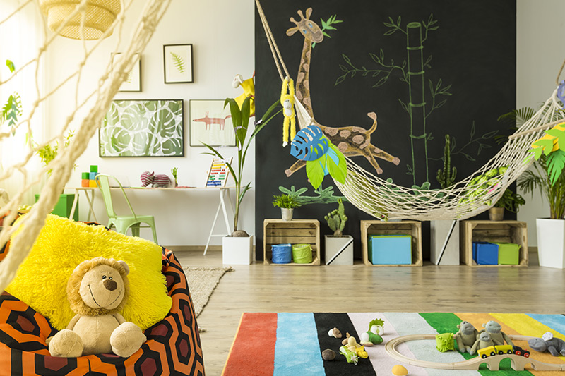 Kids home decor with a hammock and animal wall hangings with a jungle like decor for kids bedroom wall decor