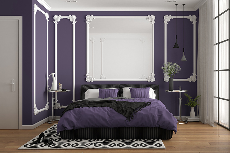 Purple bedroom colours with white wall mouldings and bedding pairs which gives the purple bedroom a touch of elegance