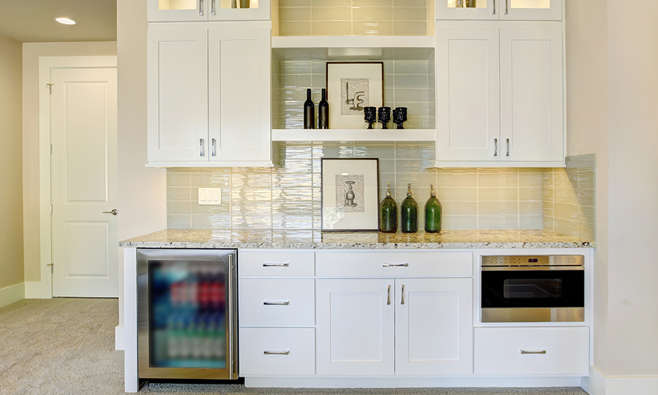Home bar cabinet fits in well in a minimalistic styled kitchen as it doesn't take too much space.