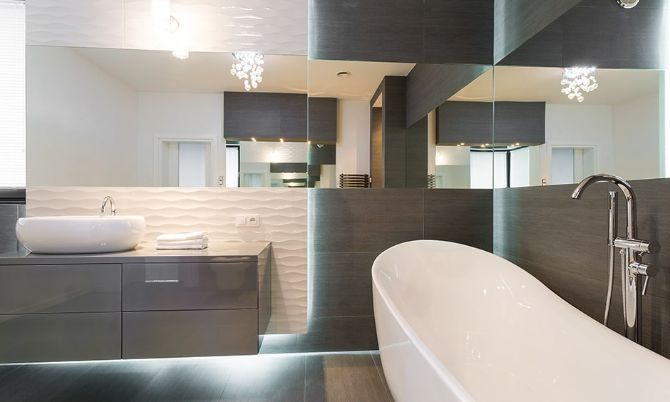 Sophisticated bathroom lightings with a wall mounted lamp right above the mirror bathroom ceiling lights