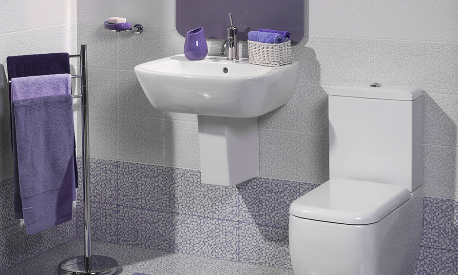 Sink design for bathroom with plain and simple design with perfectly fitted on a tiled wall with steel knob