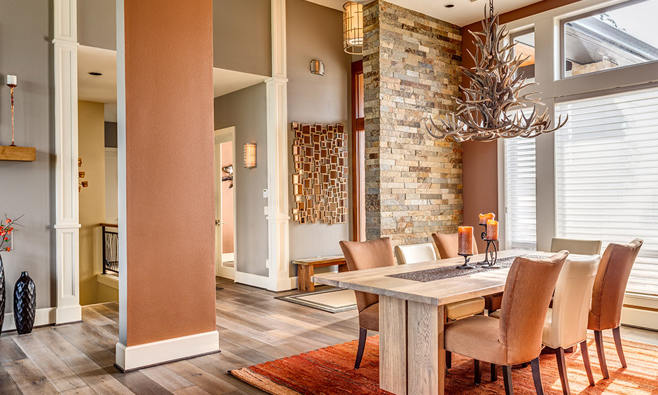 Brick dining wall decor brings in a rustic touch to the space and a feeling of natural outdoors.