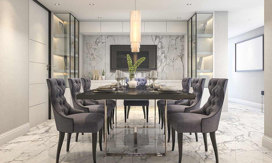 Dining wall decor with marble brings a smooth, shiny, and glamorous look.