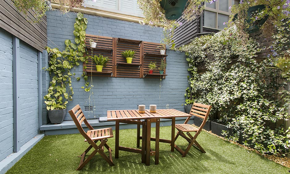 Home garden design perfect for a continental feast along the fence and lavender bushes with floating shelves