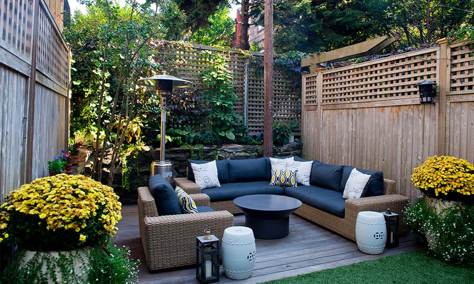 Small home garden design where you can spend quarantine time in quality with comfy sofas and a simple round table