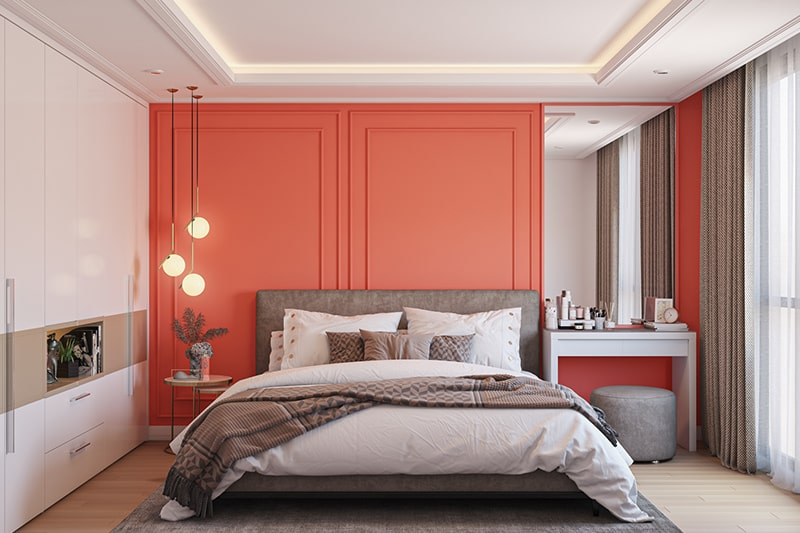 Bedroom wall color combinations with a bright shade of coral with white accents