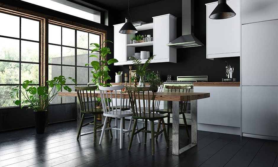Green plants bring a sense of warmth and colour to this sophisticated dark style