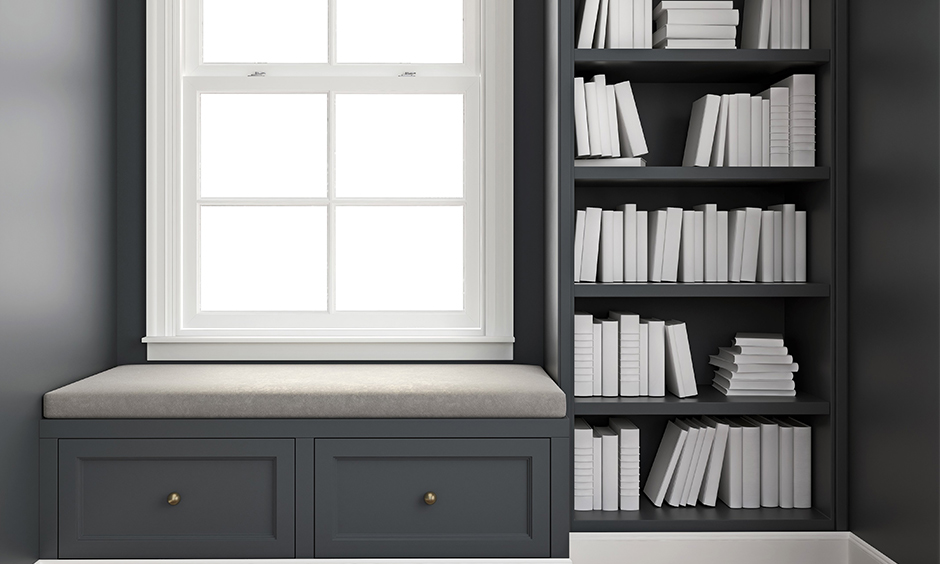 Corner window seat ideas add a bookshelf and set of drawers for some extra storage.