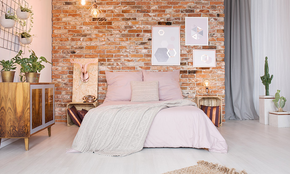 Cozy bedroom ideas, brick wall with funky art offers more than contrast and brings in a quirky twist.