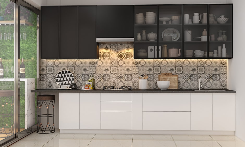 Black and white kitchen colour combination works well for a young couple