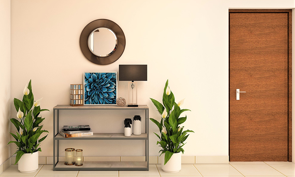 Round wall mirror design with a dark brown finish metal band frame looks simple, traditional and airier.