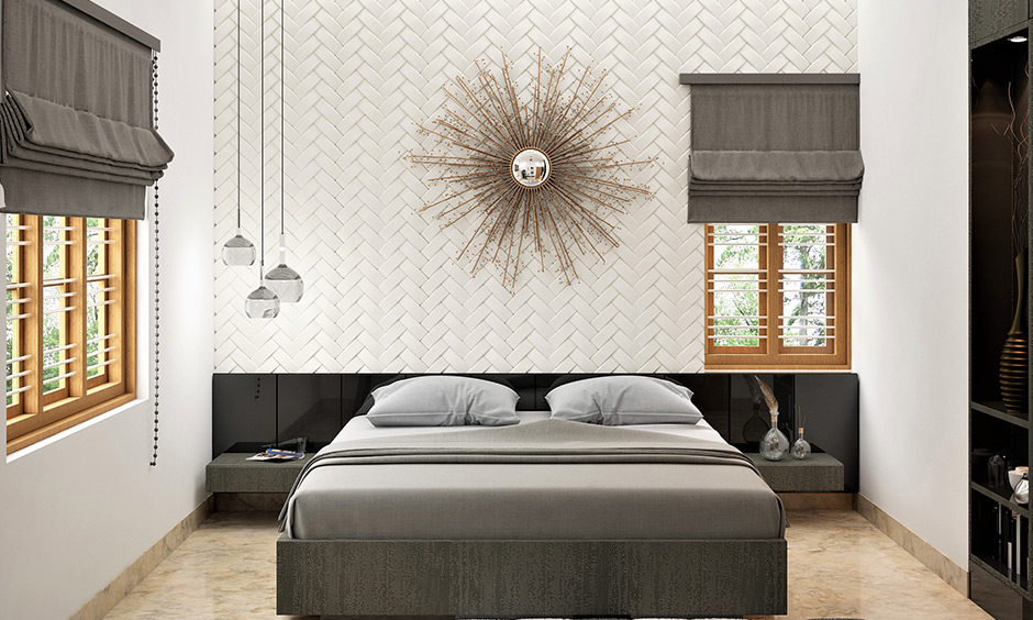 Small starburst wall mirror design looks charming and sophisticated in the white-walled and grey-themed bedroom.