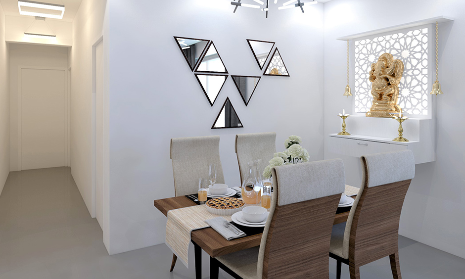 Triangular wall mirror design pairs beautifully with the sputnik chandelier and white interiors room.