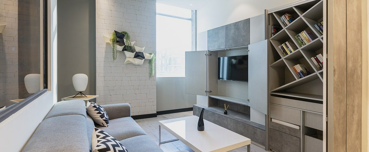 Living room concepts on display at design cafe experience store in hyderabad with hidden tv units.