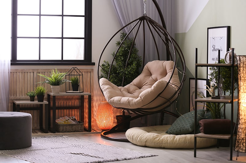 Decor your reading corner with the elegant glass floor lamp and hanging armchair for your home