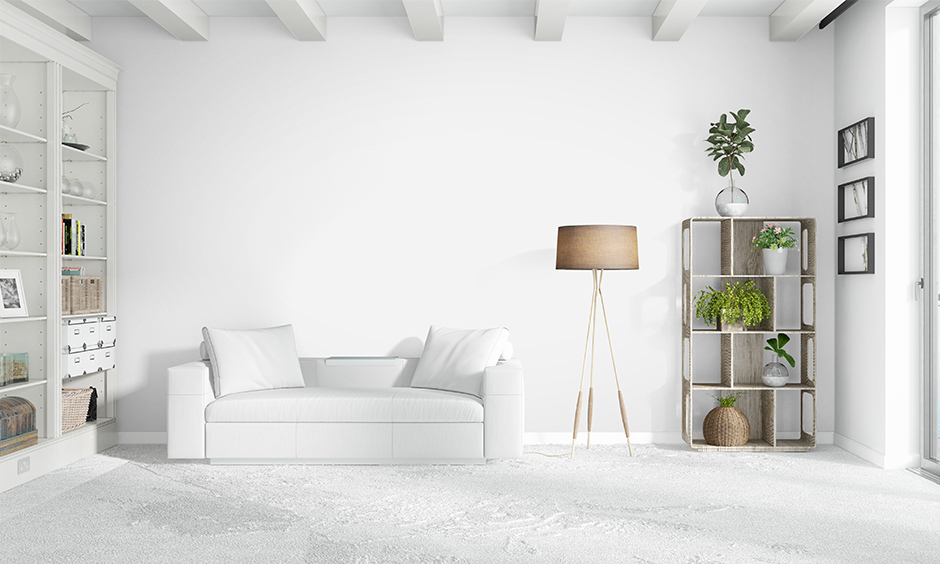 Cozy minimalist living room with all white colour with different shapes, textures, and elements