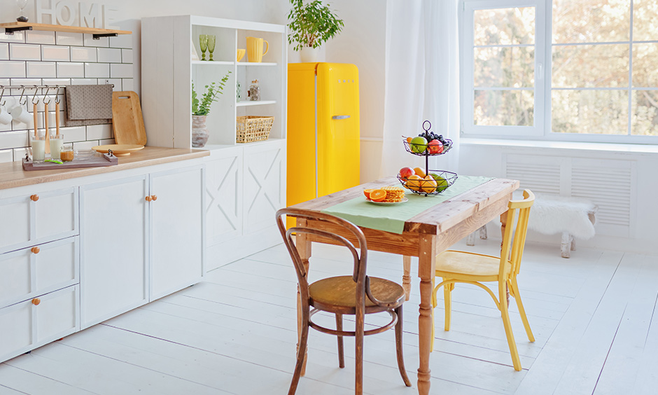 Small dining room design ideas with country style wooden table and white coloured walls look gorgeous.