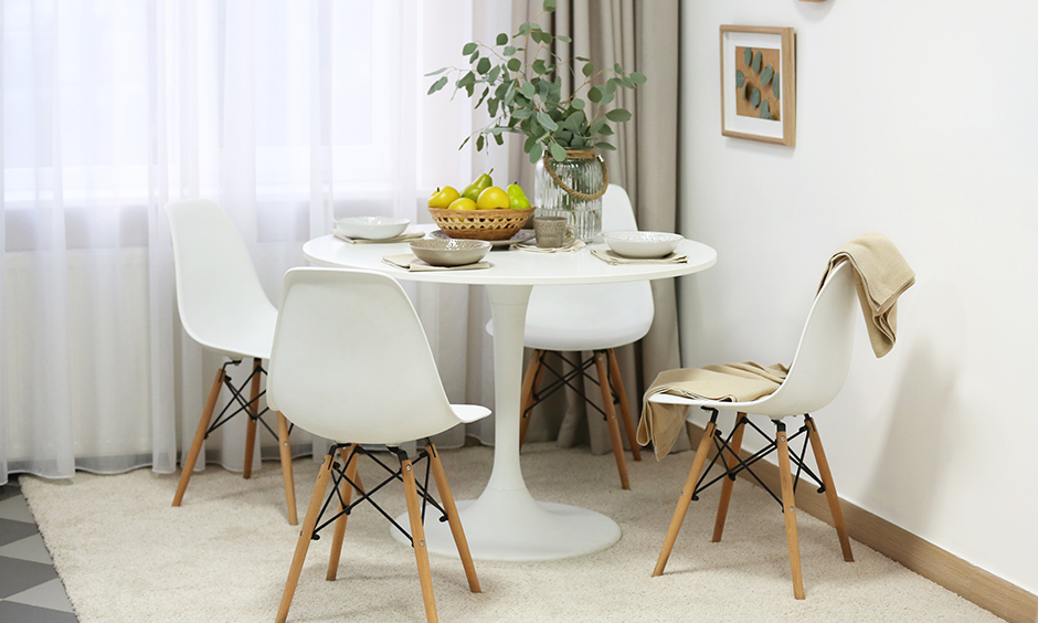Cosy small dining room with classic white round table and matching chairs are perfect for a winter's day.