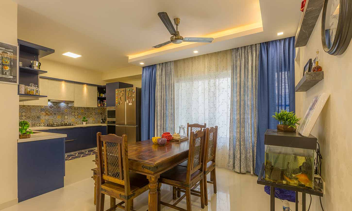 Dining room interior with living room designed by one of the top interior design firms in bangalore