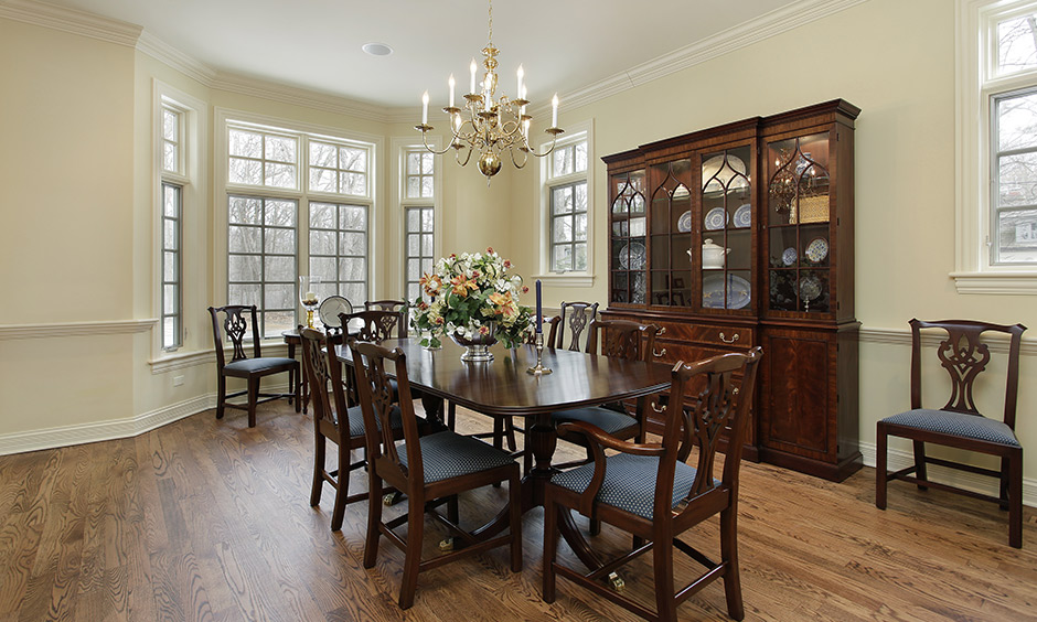 Rustic dining room lighting ideas by using chandelier lighting adds a touch of history with its candle-like bulbs.