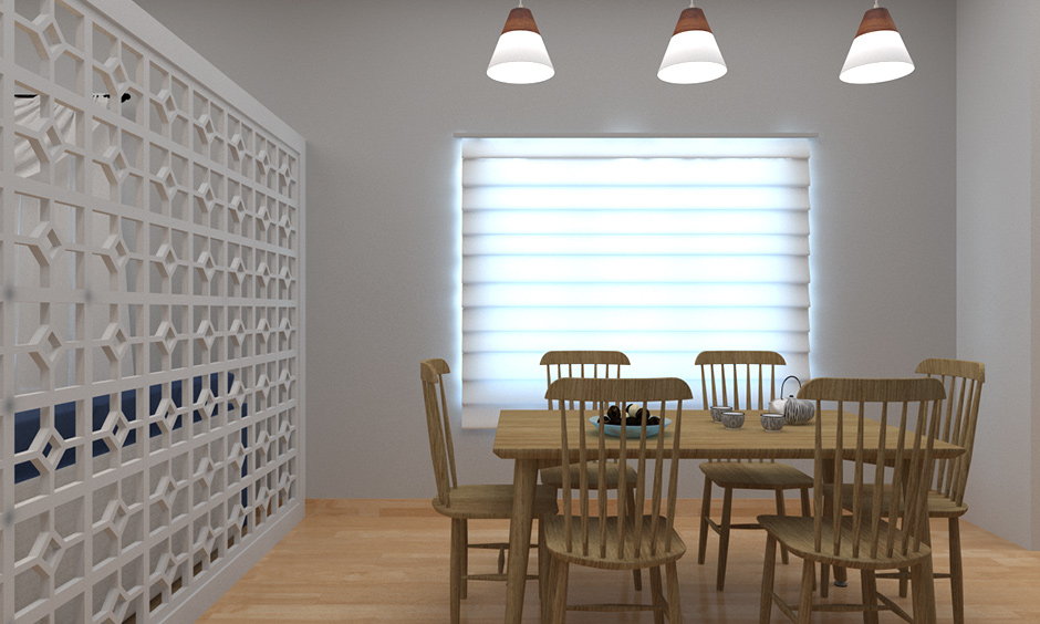 Simple cone hanging lights for dining room with the white partition with lattice work on one side.