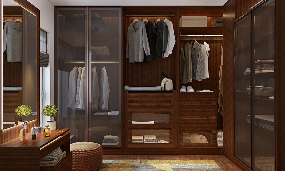His and her wardrobe design in bedroom by adding a pull-out iron board, a pull-out mirror, a shoe-display rack