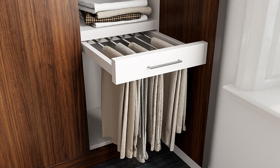 Space saving storage solution with a trouser rack in wardrobe compartment design