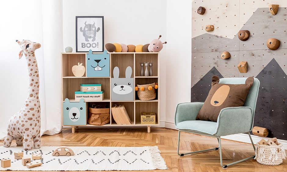 Kids playroom design ideas with climbing wall and thick cushions and a colourful mattress