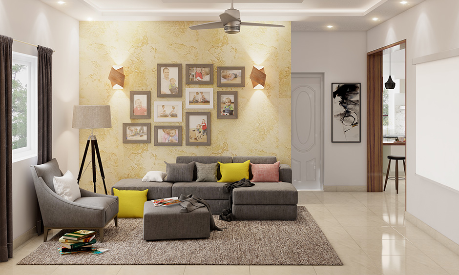 Butterscotch yellow living room textured feature wall is an eye-catcher with multi-coloured plush pillows.