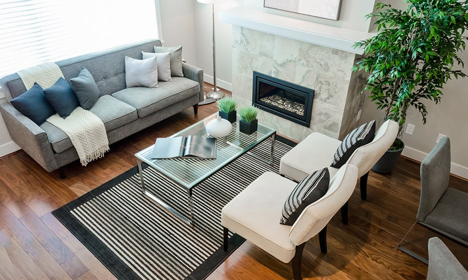 Beautiful glass coffee table design in black and white themed living room