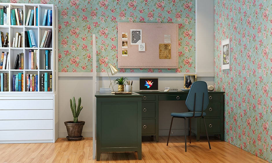Cubicle decor ideas with a pastel blue and floral printed wallpaper gives elegance look