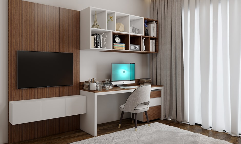Modern study table designs attached to a tv unit built with shelves for storage