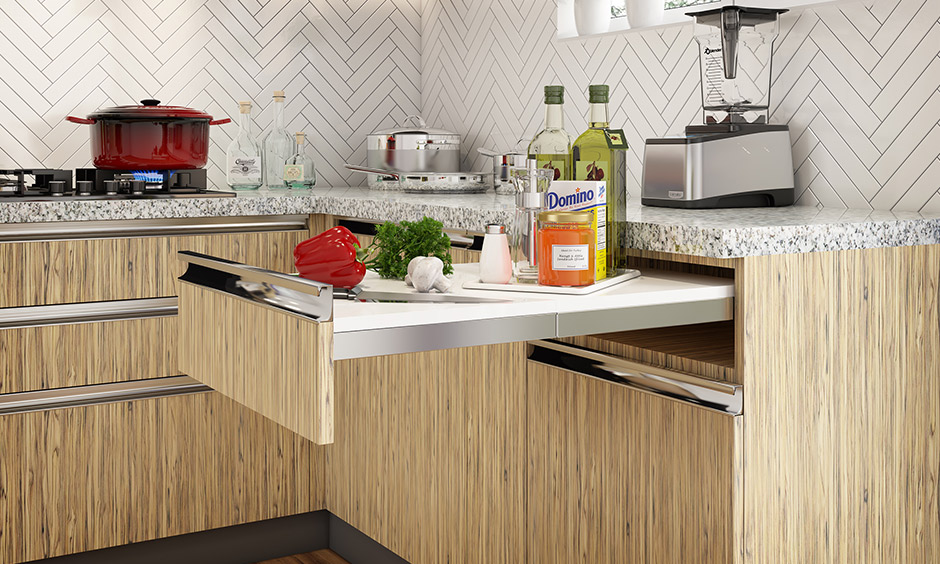 Multipurpose furniture design with a sturdy, durable chopping board pulls out in a kitchen