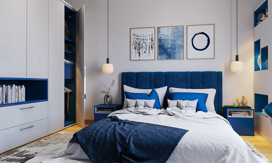 2 door wardrobe with bookshelf and a drawer that white and blue laminate is the colour scheme of this bedroom.
