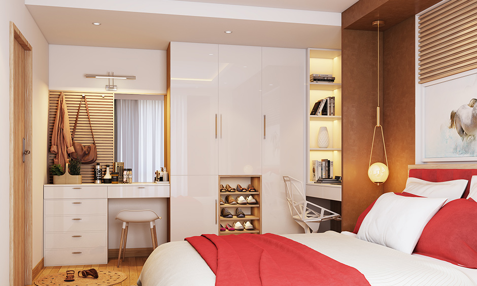 A simple swing door bedroom wardrobe with dressing table and an open shoebox is a perfect fit for a couple's bedroom