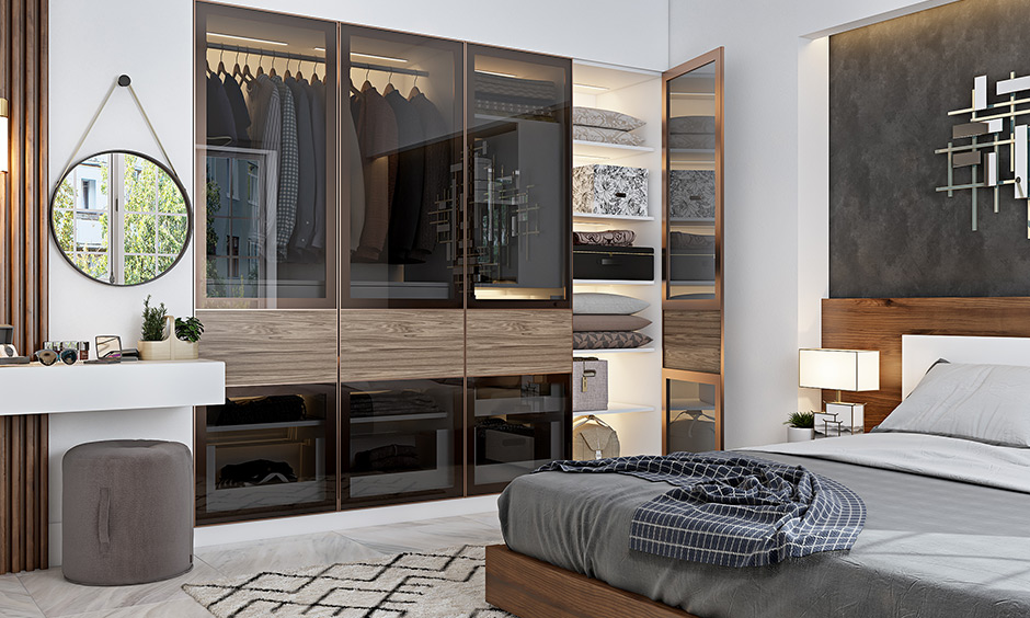 Tinted glass and aluminium wardrobe for bedroom is a great way to add a touch of luxury and can add LED strip lights inside