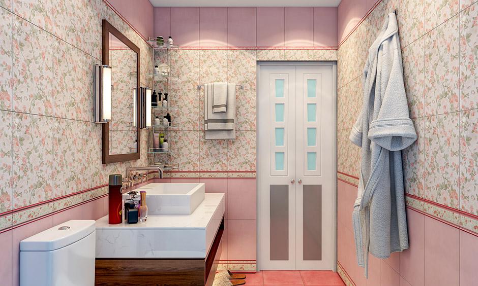 Small bathroom door design built with decorative glass panels with a bifold door design