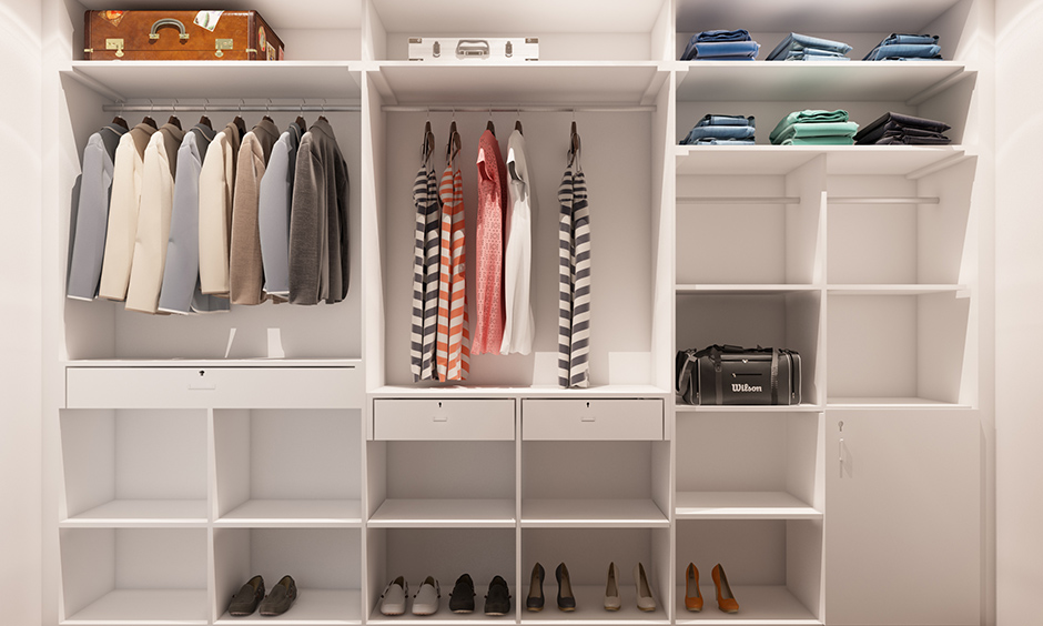 Dressing room cupboard which is all white and shelves and drawers are basic