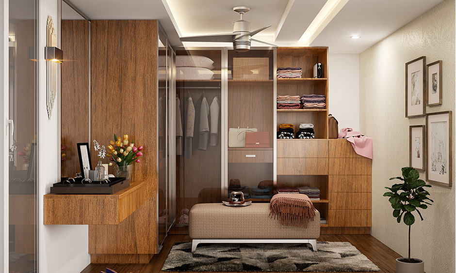 Classic wooden cupboard design for dressing room complete with drawers, shelves and glass cabinets for storage