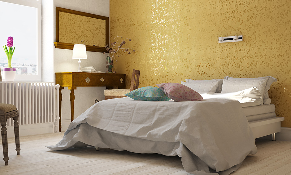 This gold wallpaper designs single handedly brightens up the interior designs of this bedroom and infuses glamour and charm