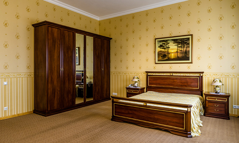 This stunning bedroom design is a mix of pretty motifs gold wall texture & subtle golden stripes looks gorgeous