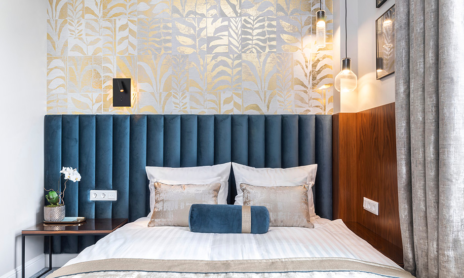 Gold wallpaper for the bedroom wall works exceptionally well and helps in uplifting the look of the entire space